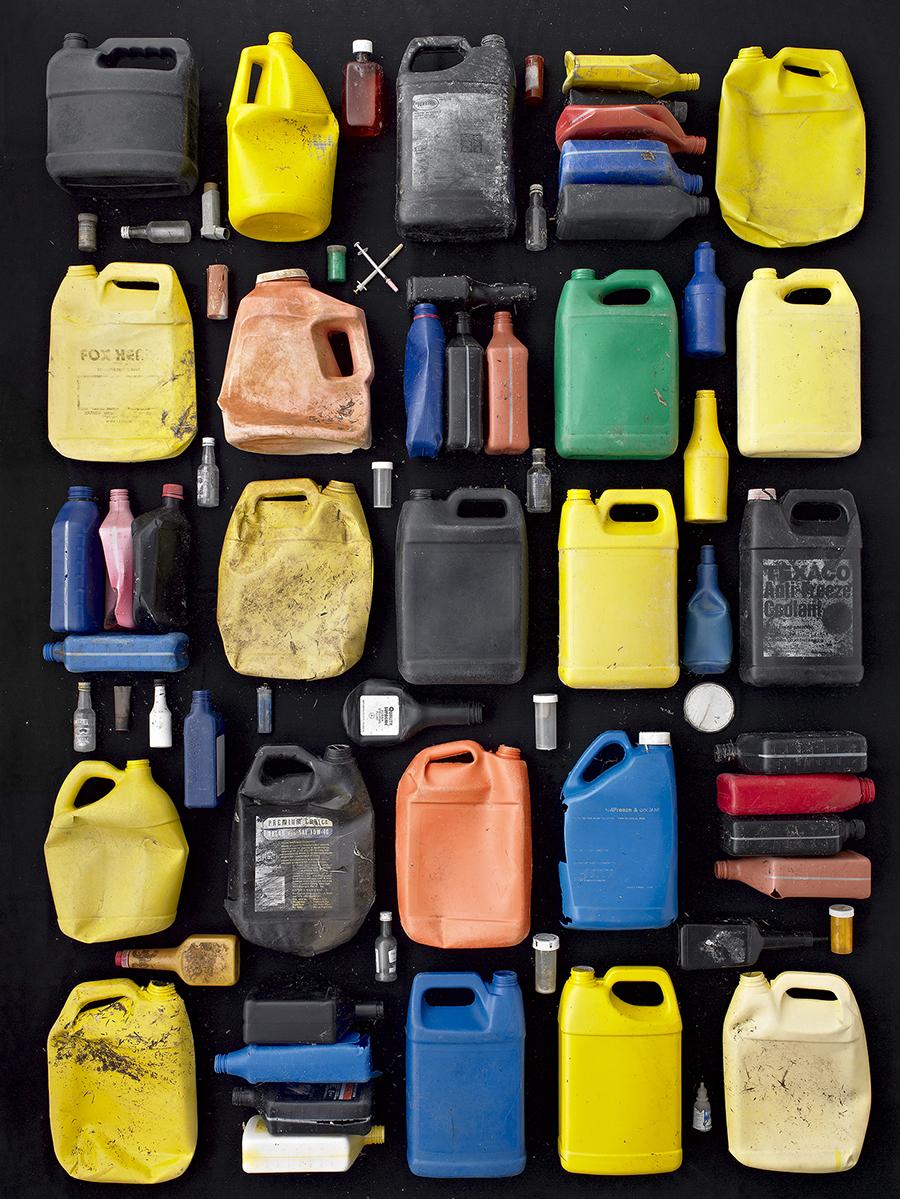 52 plastic bottles on a black background
